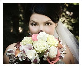 A bride's face behind her flowers.