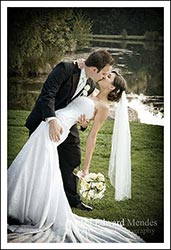 Couple kissing with groom dipping bride