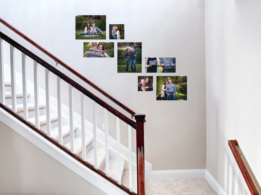 Engaged couple portrait wall art dispay near stairs